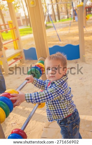 Boy learning to count at a playground - stock photo