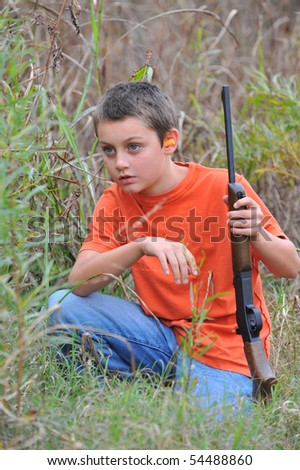 Boy listening for game - stock photo