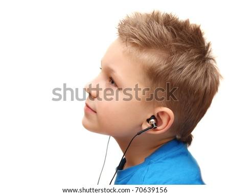 Boy listening music, isolated on white background. - stock photo