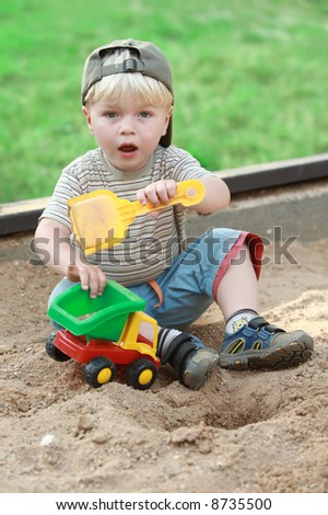 boy little children child play playground color toy sand life outdoor spring sand - stock photo