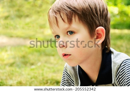 boy looking away with interest in the park. horizontal - stock photo