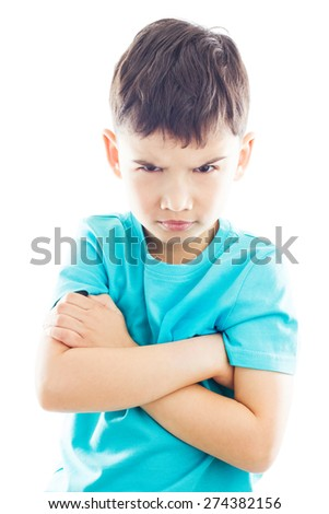 Boy looking frown and folding one's arms - stock photo