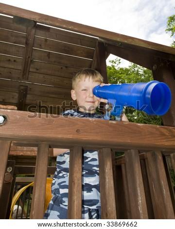 Boy Looking through a SpyGlass - stock photo