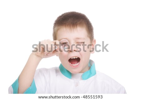 Boy looking through magnifying glass with open mouth