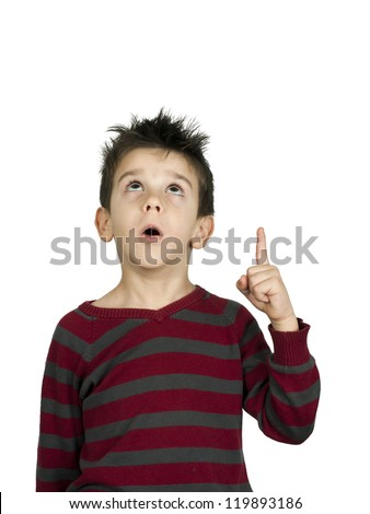 Boy looking up and indicating with his hand up - stock photo