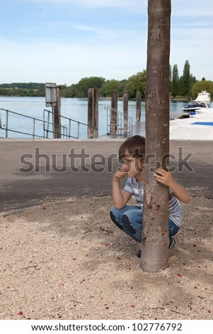 boy looks at the river - stock photo