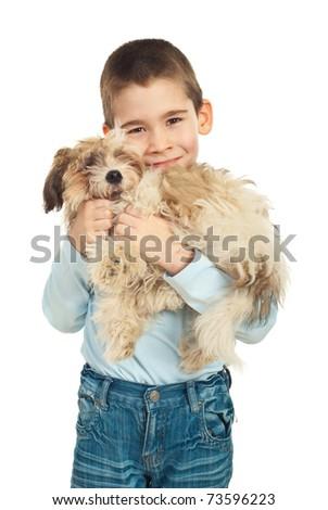 Boy loving and bonding his puppy fluffy dog over white background - stock photo