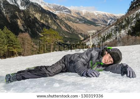 Boy lying on the snow. Stock Photo - stock photo