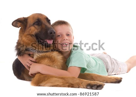 boy lying with his dog - stock photo