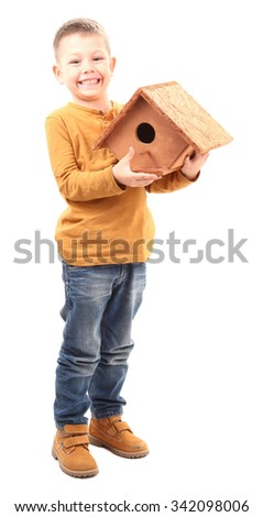 Boy made a wooden house for birds and holding it proudly - stock photo