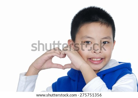 Boy makes a gesture in the form of the heart. - stock photo