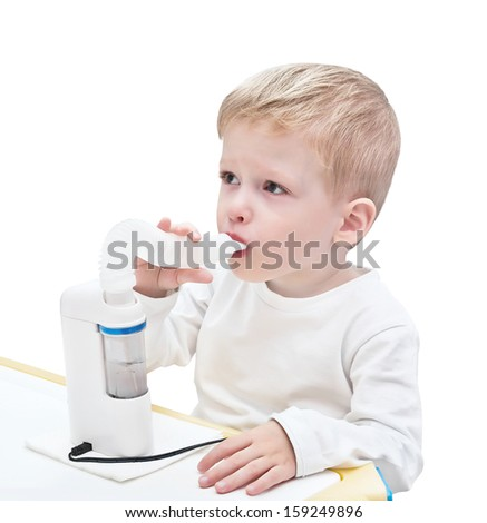 Boy makes inhalation with medical ultrasonic inhaler (nebulizer, nebuliser) nebular. Respiratory medicine. Asthma breathing treatment. Bronchitis health equipment, isolated on the white background