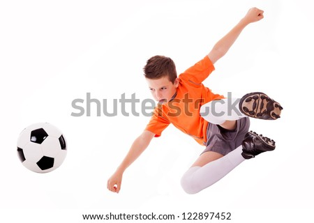 Boy making a acrobatic kick with soccer ball, isolated on white background. - stock photo
