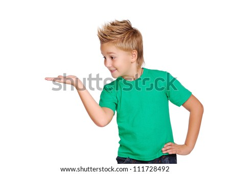 Boy making a presenting gesture with his palm - stock photo