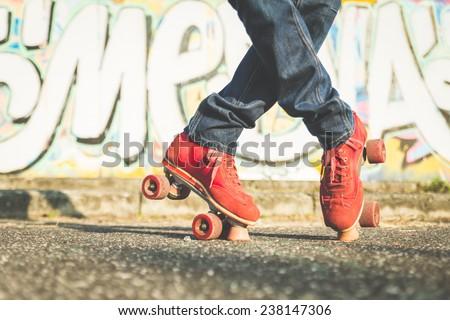 boy making cross position on roller skates - stock photo