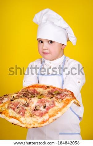 Boy making pizza - stock photo