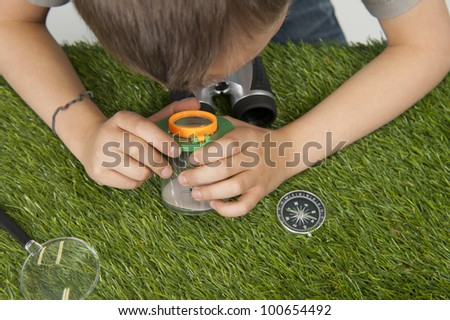 boy observing nature - stock photo