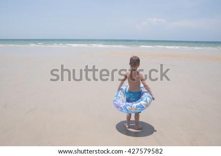 Boy on a beach in Thailand - stock photo