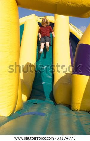 Boy on a Slide - stock photo