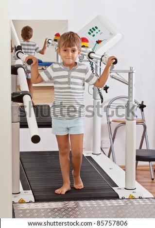 Boy on a Treadmill - stock photo
