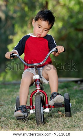 Boy on a Tricycle - stock photo