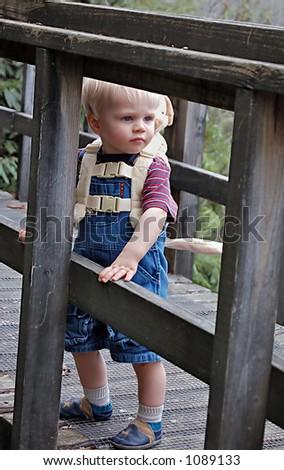 boy on bridge looking back - stock photo