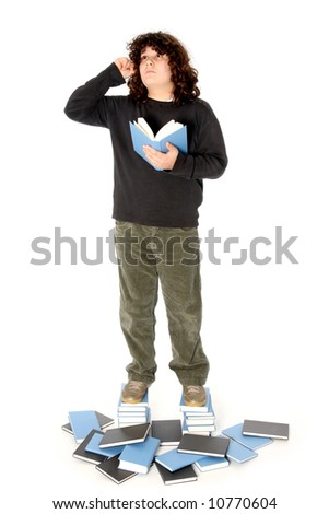 boy on stack of books on white background - stock photo