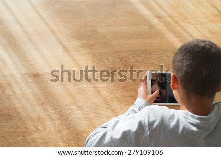 Boy on tablet pc - stock photo
