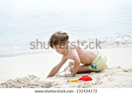 boy on the beach - stock photo