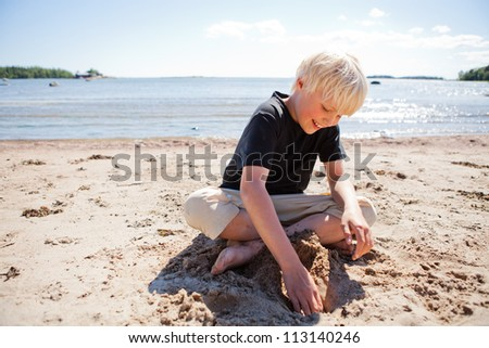 Boy on the beach on a beautiful sunny summer day