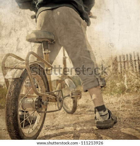 boy on the bike in grunge style - stock photo