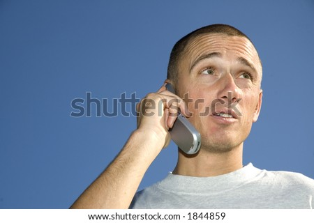 Boy on the phone looking surprised - stock photo