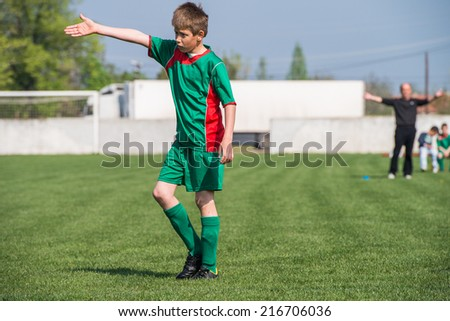 boy on the sports field - stock photo