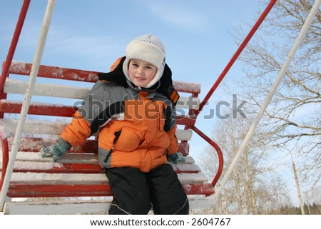 boy on winter seesaw