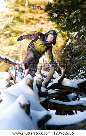 boy outdoors in winter snowshoeing - stock photo