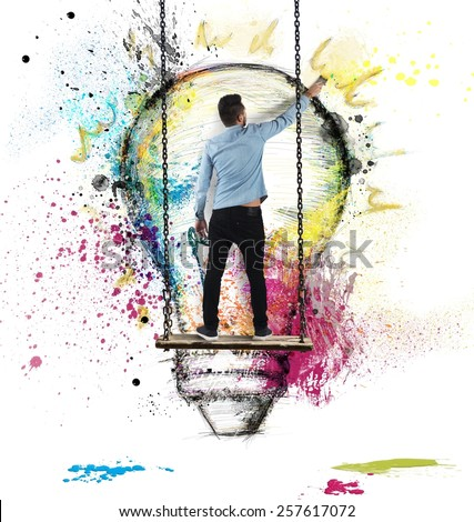 Boy paints on wall a colorful idea - stock photo