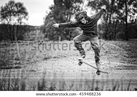 Boy Performs A Trick On A Skateboard