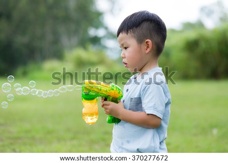 Boy play with bubble blower