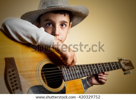 Boy playing acoustic guitar. - stock photo