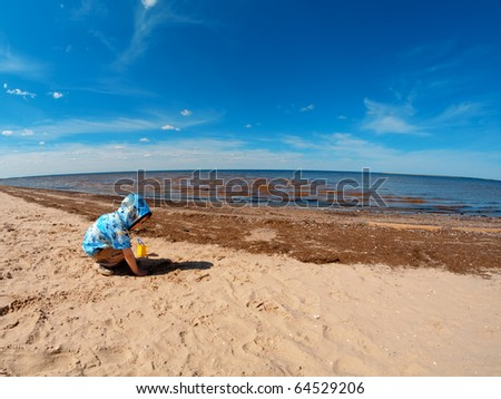 boy playing at the beach .White Sea