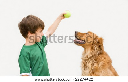 Boy Playing Ball with Dog - stock photo