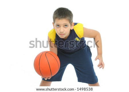 Boy playing basketball isolated. - stock photo