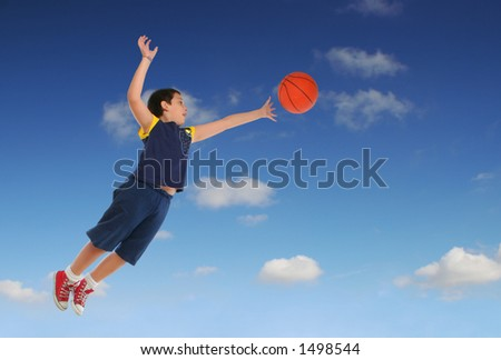Boy playing basketball jumping and flying. Blue sky. - stock photo