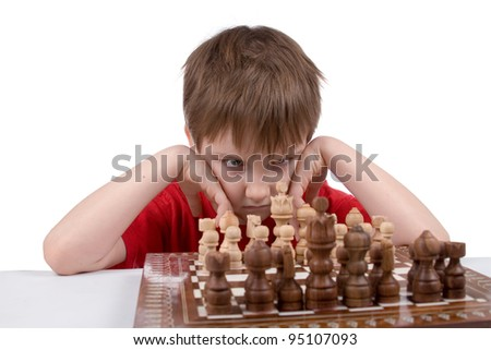 Boy playing chess  on a white background - stock photo