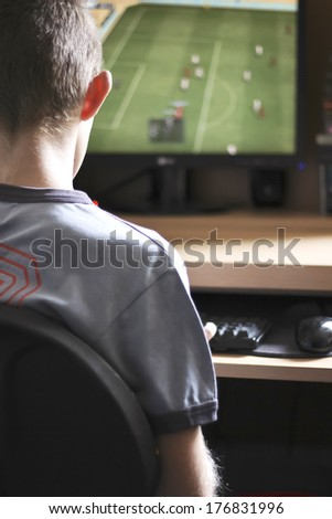 Boy playing computer games - stock photo