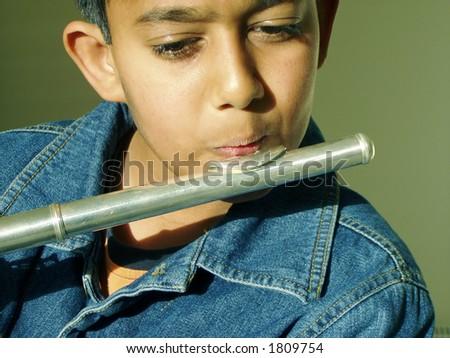 boy playing flute - stock photo
