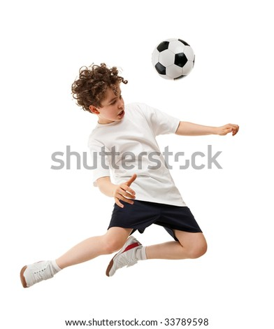 Boy playing football isolated on white background - stock photo