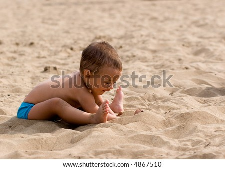 Boy playing in sand - stock photo