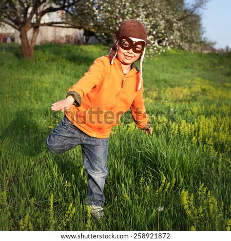 boy playing in the pilot - stock photo