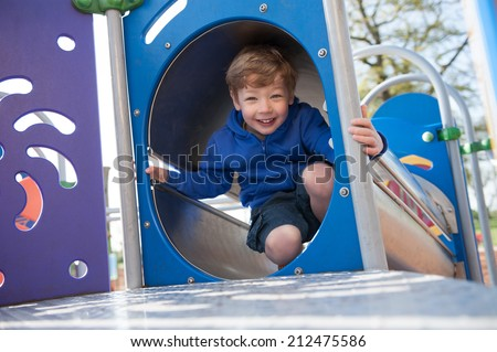 Boy playing in the playground. - stock photo
